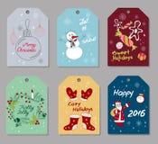 Uppsättning av gåvaetiketter för jul och för nytt år Royaltyfri Foto