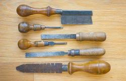 Uppsättning av gamla hjälpmedel med trähandtag Royaltyfri Bild