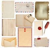Uppsättning av gamla pappersark, bok, kuvert, kort Arkivbild