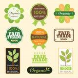 Uppsättning av garantietiketten för organisk non kemisk kvalitet och för ganska handel royaltyfri illustrationer