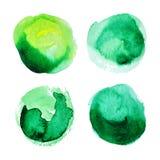 Uppsättning av gröna akvarellfläckar Arkivbild