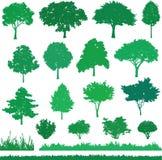 Uppsättning av grönt träd, buske och gräs Arkivfoto