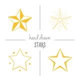 Uppsättning av gul hand drog stjärnor Fotografering för Bildbyråer