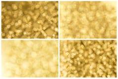 Uppsättning av guld- abstrakt bakgrund Arkivbild