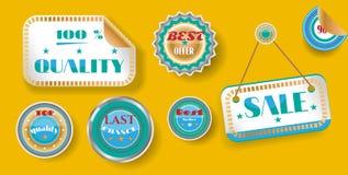Uppsättning av guld- blåa klistermärkear med text på guling Arkivfoto
