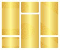 Uppsättning av guld- broschyr- och affärskortmallar vektor illustrationer
