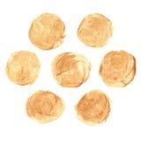 Uppsättning av guld- fläckar, borsteslaglängder Royaltyfria Bilder