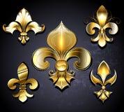 Uppsättning av guld- Fleur de Lis Royaltyfria Foton