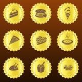 Uppsättning av guld- mat-släkta emblem eller medaljer vektor illustrationer