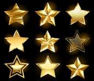 Uppsättning av guld- stjärnor vektor illustrationer