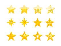 Uppsättning av guld- stjärnor på vit bakgrund Arkivbild