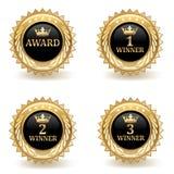 Uppsättning av guld- utmärkelseemblem Royaltyfria Bilder