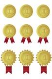 Uppsättning av guldmedaljer med röda band Royaltyfri Fotografi