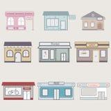 Uppsättning av gulliga byggnader för infographics arkivbild