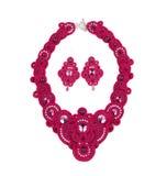 Uppsättning av härlig halsband och örhängen royaltyfria foton