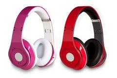 Uppsättning av hörlurar i olika färger Arkivfoto