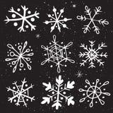 Uppsättning av hand-drog snöflingor Royaltyfria Bilder