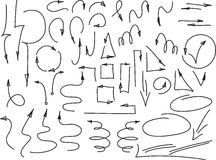 Uppsättning av hand drog tunna pilar och andra beståndsdelar, på vit också vektor för coreldrawillustration Arkivbild
