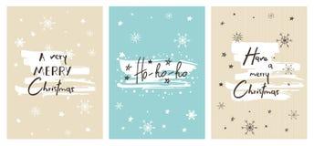 Uppsättning av idérika julkort med hand dragen bokstäver Ha mycket glad jul HO-HO-HO Royaltyfri Fotografi