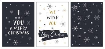 Uppsättning av idérika julkort med hand dragen bokstäver Vi önskar dig glad jul Royaltyfri Fotografi