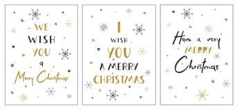 Uppsättning av idérika julkort med hand dragen bokstäver Vi önskar dig glad jul Uppsättning av idérika julkort med han Arkivbild