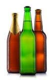 Uppsättning av isolerade ölflaskor royaltyfri foto