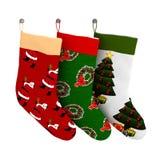 Uppsättning av isolerade färgrika julgåvasockor Royaltyfri Foto