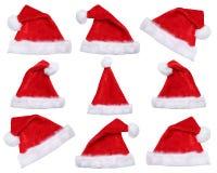Uppsättning av isolerade Santa Claus hattar på jul i vinter Fotografering för Bildbyråer