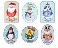 Uppsättning av juletiketter med jultomten, snöjungfrun och roliga djur Arkivbild