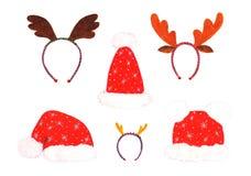 Uppsättning av julhattar Santa Claus och beslag med horn av hjortvattenfärgen Arkivbilder