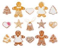 Uppsättning av julpepparkakan - söta kakor i form av feriesymboler och objekt arkivfoton