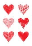 Uppsättning av klottrade hjärtor Stock Illustrationer