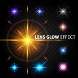Uppsättning av ljusa ljusa effekter på en genomskinlig mörk bakgrund Effekten linsen, solglödet, design för julen och Royaltyfria Foton