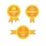 Uppsättning av logoer för honungprodukter royaltyfri bild