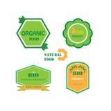Uppsättning av logoer för organisk och naturlig mat royaltyfri foto