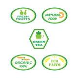 Uppsättning av logoer för organisk och naturlig mat arkivfoton