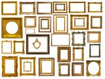 Uppsättning av många guld- ramar. Isolerat över vit Arkivfoton