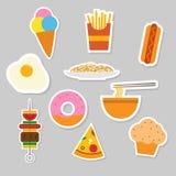 Uppsättning av matklistermärkesymbolen Arkivfoton
