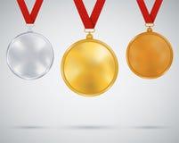 Uppsättning av medaljer, guld, silver och brons Royaltyfri Bild