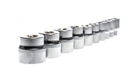 Uppsättning av metalliska hjälpmedel för hålighetskiftnyckel som isoleras på vit bakgrund Royaltyfri Fotografi