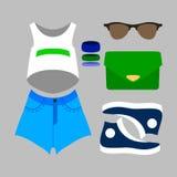 Uppsättning av moderiktig flickas sportkläder Arkivbild