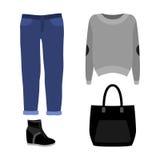 Uppsättning av moderiktiga kvinnors kläder med jeans, sweater Arkivbilder
