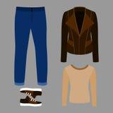 Uppsättning av moderiktiga mäns kläder med vippaomslaget, sweater, jeans Arkivbild