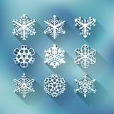 Uppsättning av nio moderna snöflingor royaltyfri illustrationer