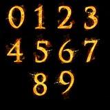 Uppsättning av nummer i flammor Arkivbild