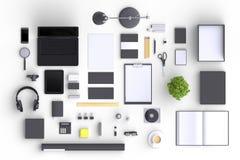 Uppsättning av objekt för variationsmellanrumskontor som organiseras för företagspresentation eller brännmärkas identitet med tom Arkivfoto