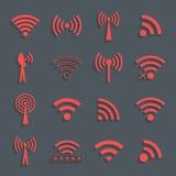 Uppsättning av olika röda vektorwifisymboler för kommunikation och rem Royaltyfri Bild