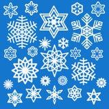 Uppsättning av olika vita snöflingasymboler Arkivbilder