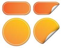 Uppsättning av orange klistermärkear Arkivbilder