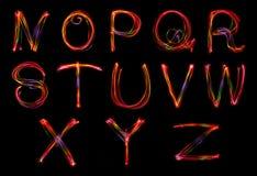 Uppsättning av ord som skriver från ljus Royaltyfria Bilder
